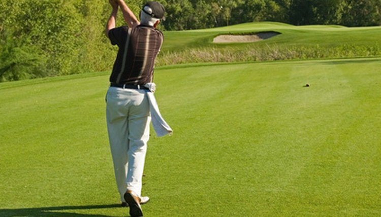 Your arms, shoulders and core should work together smoothly for a good golf swing.