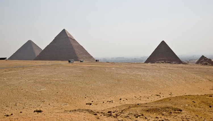 Pharoahs directed the building the Pyramids as their burial places.