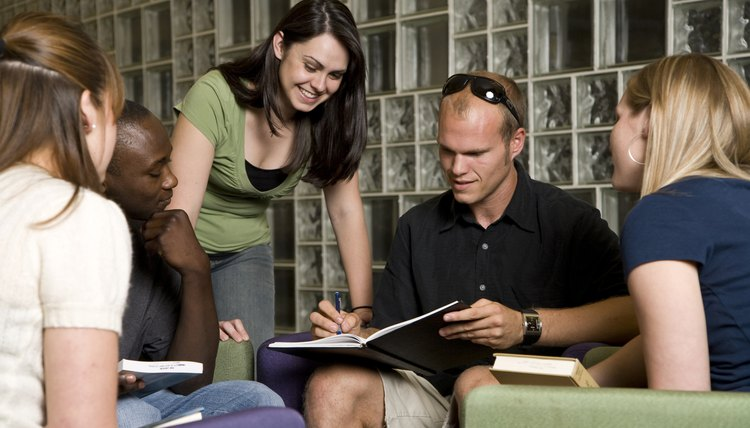 Group of young adults studying together in library