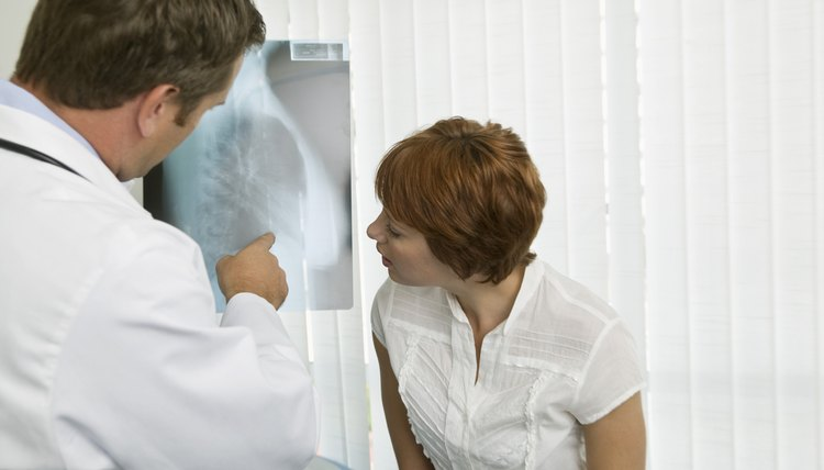 doctor and patient examining x ray - X Ray Technologist Job Description