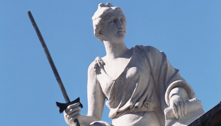 Lady Justice holds her sword high.