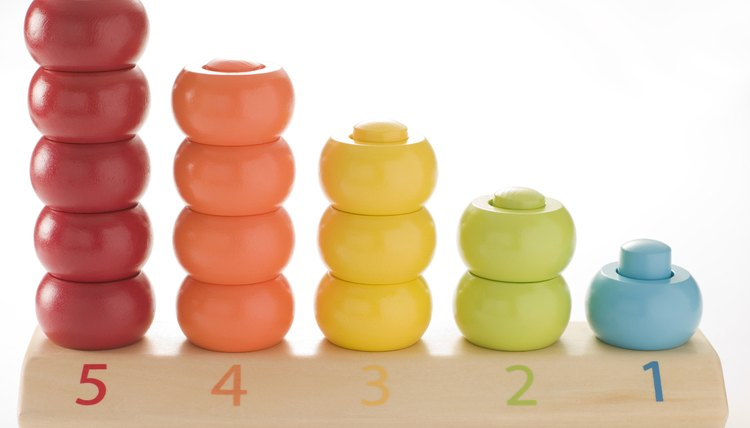 Children often use colorful manipulatives when learning to count groups of objects.