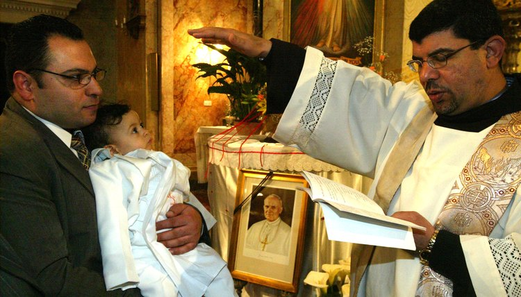 Young child being baptised inside cathedral