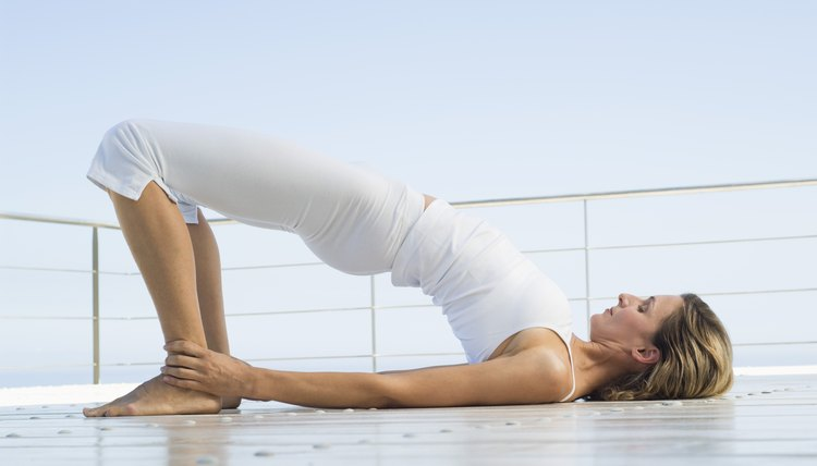The supine bridge pose strengthens core muscles.