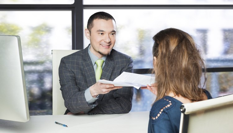 Succesful job interview - applicant handing CV