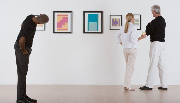 Looking at paintings in museum.