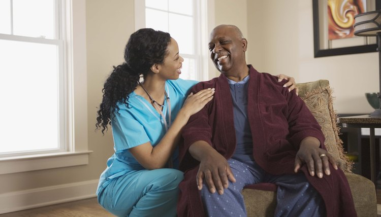 Nurse smiling with patient at home