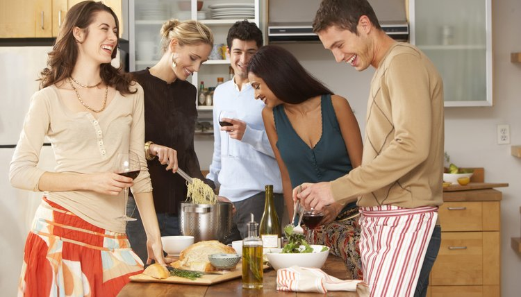 Cook a gourmet meal with your friends and share it with a glass of wine.