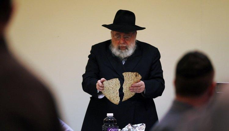The seder leader breaks one piece of matzah in half, creating the afikomen.