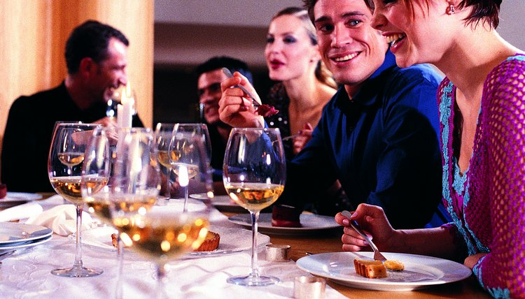 Experts agree that it would be better to reduce the guest list or food options than ask guests to pay (See Ref. 1,2).