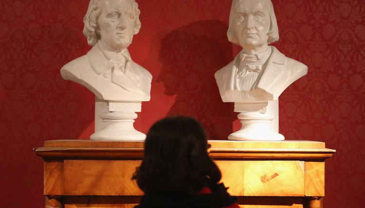 Busts of brothers Jacob and Wilhelm Grimm, who were both devout Calvinists.