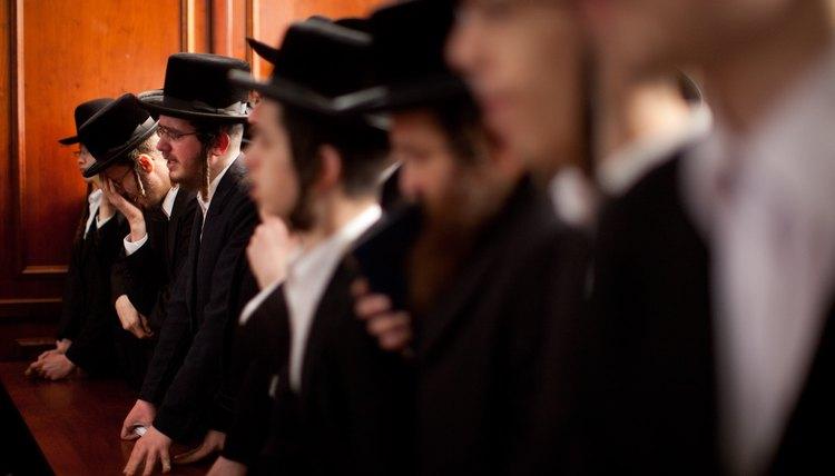 Orthodox Jewish men wear payos, or side curls.
