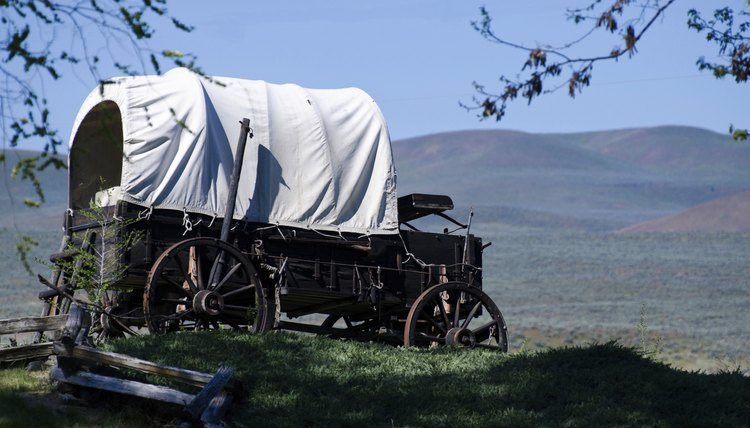Most pioneers traveled West with small, covered wagons.