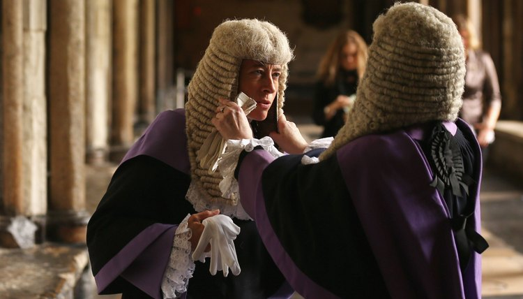 A judge preparing for court in Westminster Abbey.
