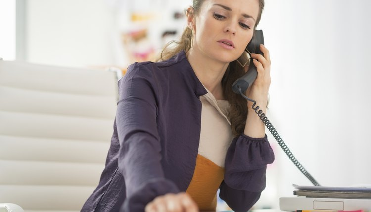 concerned fashion designer talking phone in office