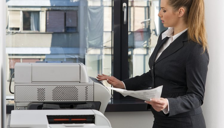 business woman working on printer