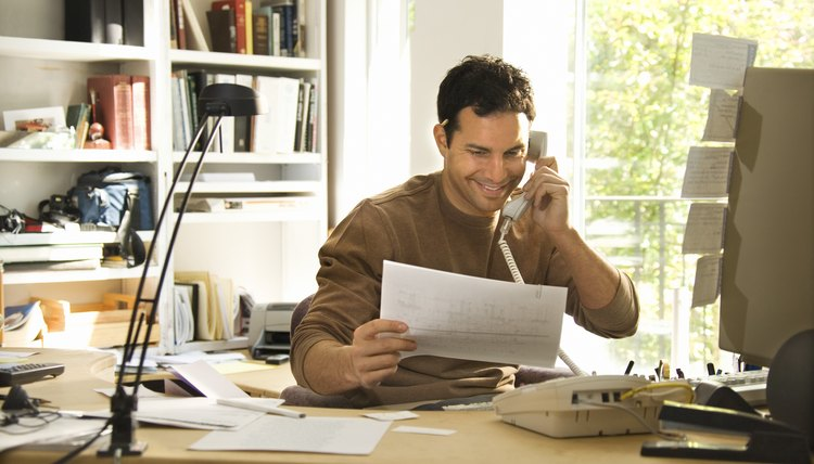 Man using telephone in home office