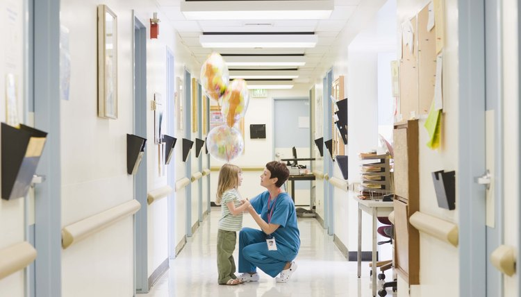 Doctor with girl in hospital