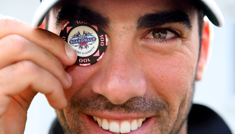 Spain's Alvaro Quiros shows off the poker chip he uses as his ball marker.