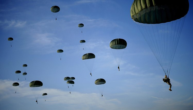 Paratroopers jumping.