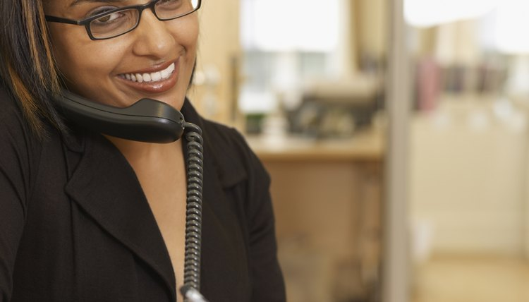 Indian businesswoman talking on telephone