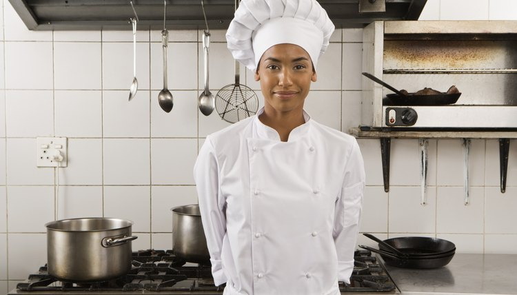 Portrait of smiling chef in kitchen