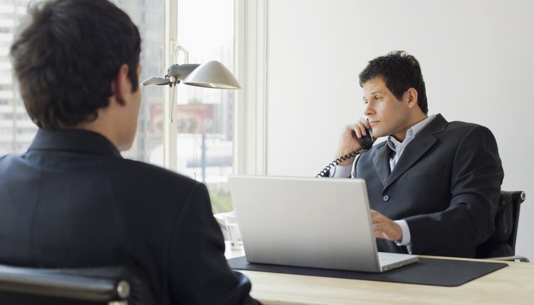 Businessmen in office on telephone