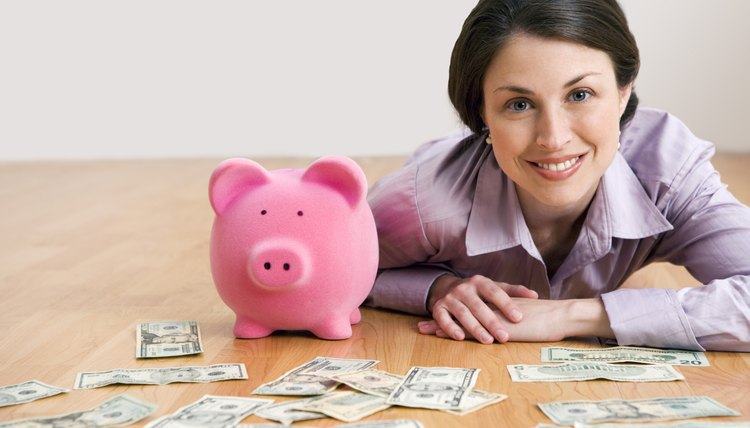 woman with money and piggy bank