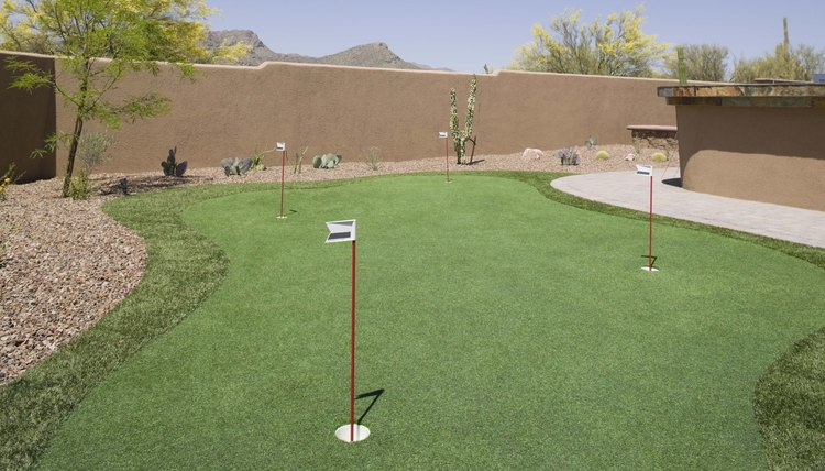 Create a small set of greens in your backyard and your putting stroke just might improve.