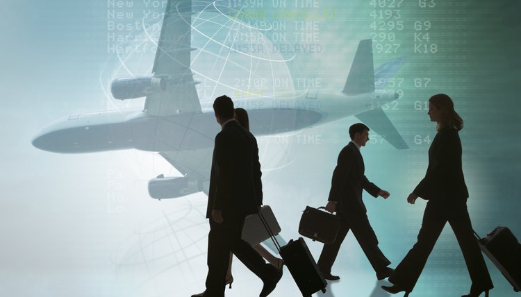 Silhouettes of businesspeople walking with suitcases and airplane
