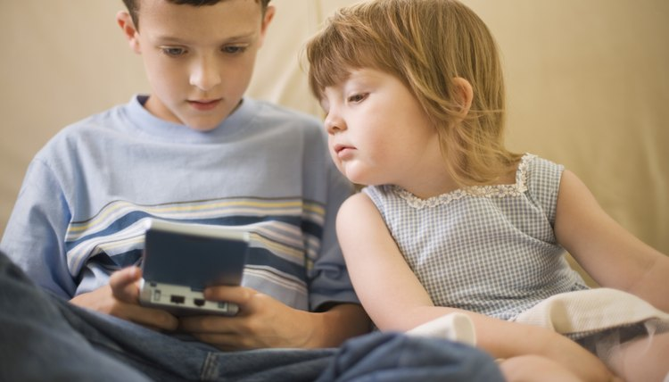 Handheld electronic games can help your 4-year-old learn while he plays.