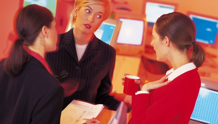 businesswomen standing and talking in office (infrared)