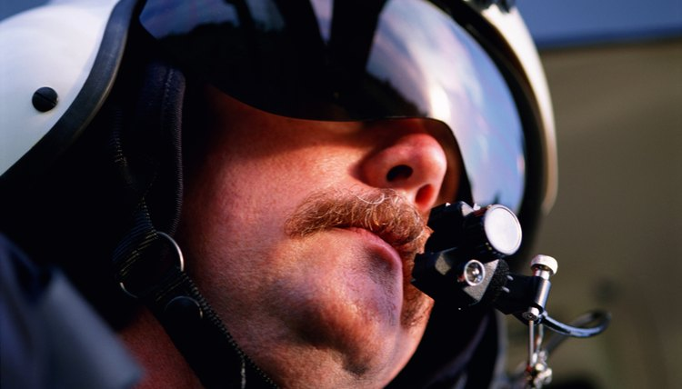 Helicopter pilot wearing helmet and headset