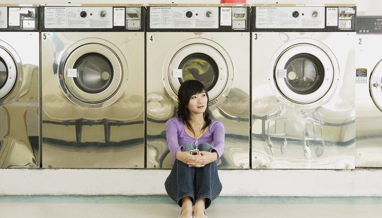 Asian woman in laundromat