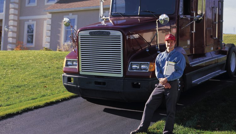 Man posing by big rig cab parked by house
