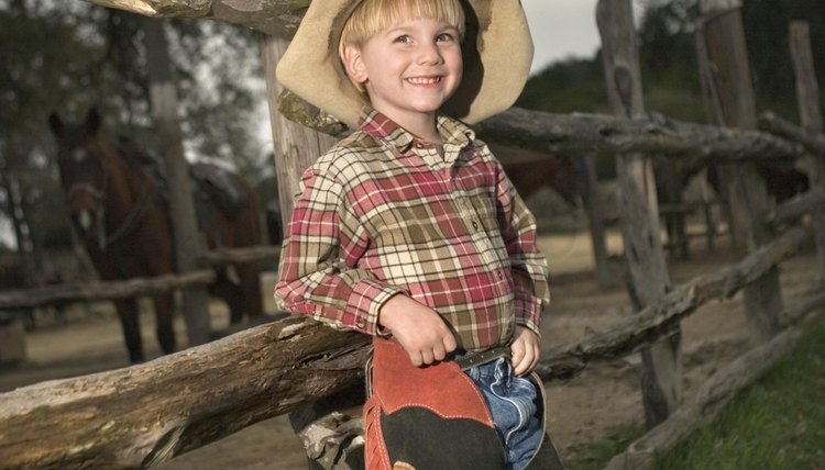 Smiling kindergartener dressed up as a cowboy