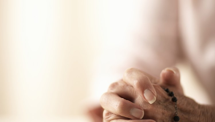 Close-up of woman's hands during prayer.