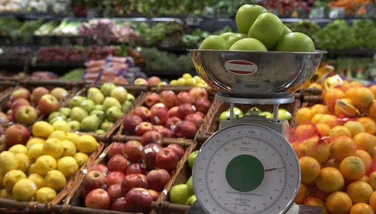 Apples on weighing scale in supermarket
