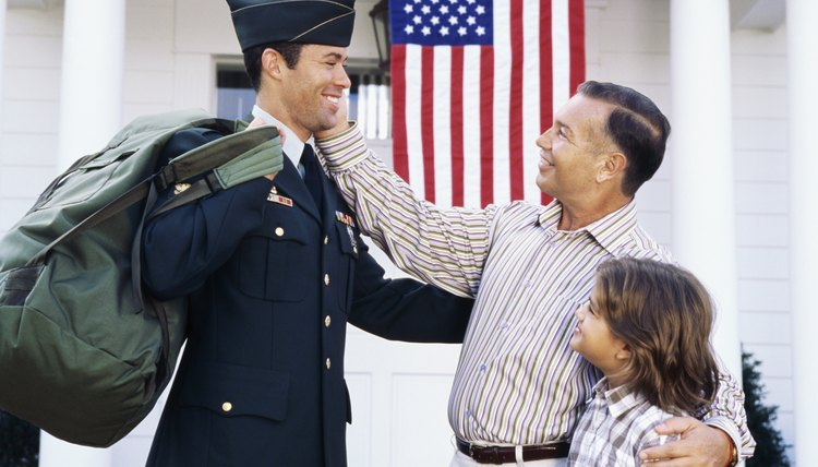 A proud family standing by a young man dressed in military uniform.