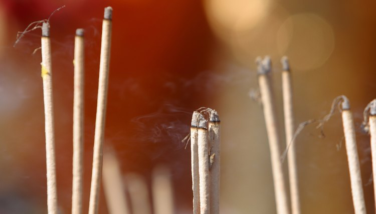 Buddhist incense can take the form of long sticks or granules placed in an incense burner.