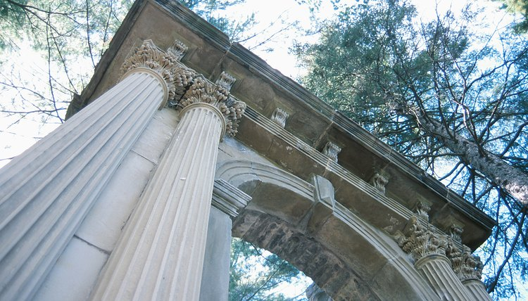 A high-angle view of ancient Greek pillars in the tree tops.
