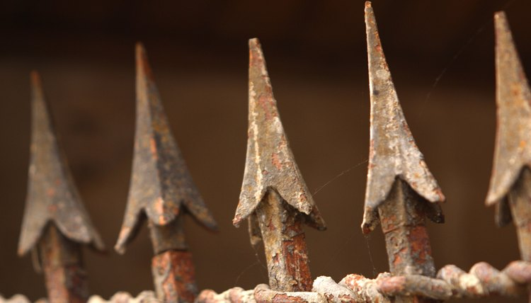 Close-up of rusty spikes on wrought iron fence