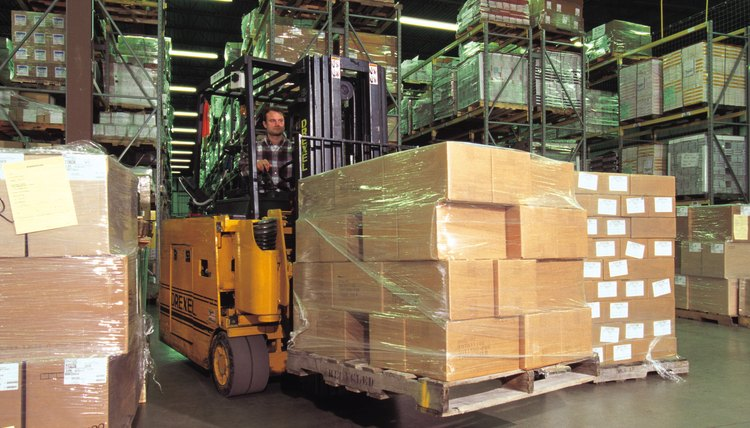 Forklift with boxes in warehouse