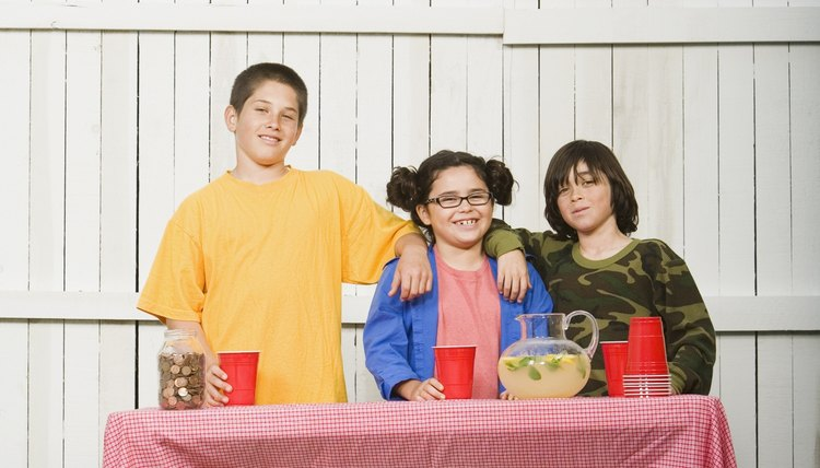 Students running a lemonade stand.