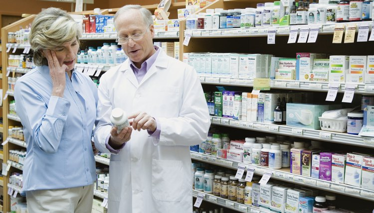 Health Food Store Pharmacist Assisting Customer