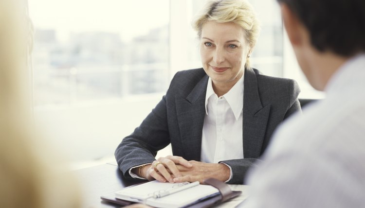 Mature businesswoman in meeting