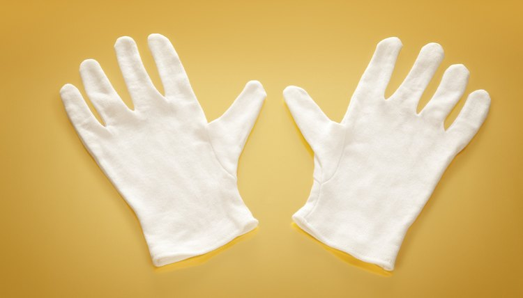 White gloves on yellow background.