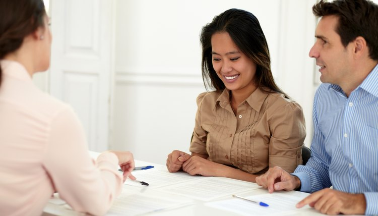 Young couple working with financial advisor