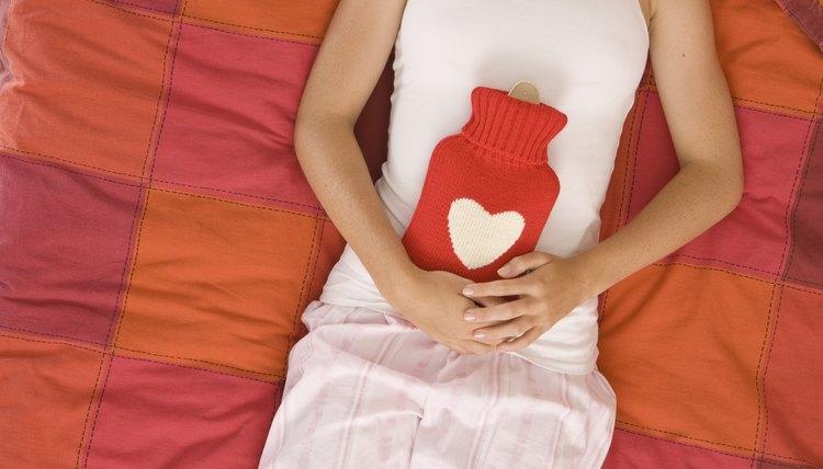 Teenage girl with heat pad on stomach