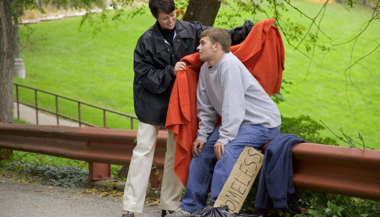 Social worker helping homeless teenage boy